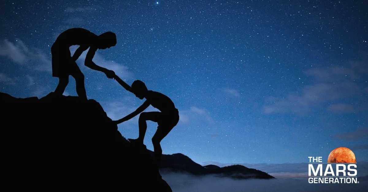 Astronaut Abby_Getting Back Up_Two People Supporting Eachother Up Mountain_The Mars Generation